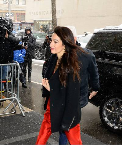 Amal Clooney is seen arriving with gifts at The Mark Hotel for the Duchess of Sussex\'s baby shower.