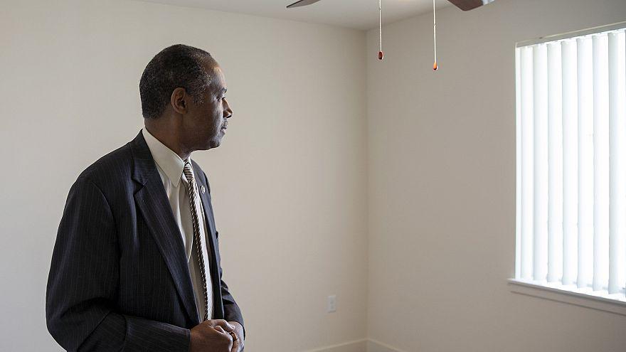 Image: Housing and Urban Development Secretary Ben Carson stands in an empt