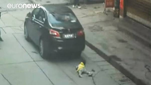 Little girl survives being run over in China