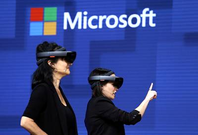 Members of a design team at Cirque du Soleil demonstrate use of Microsoft\'s HoloLens device in helping to virtually design a set at the Microsoft Build 2017 developers conference in Seattle on May 11, 2017.