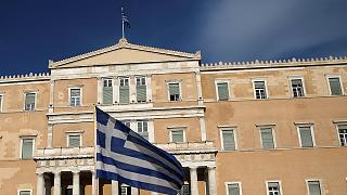 Greek parliament approves more pension cuts and tax hikes