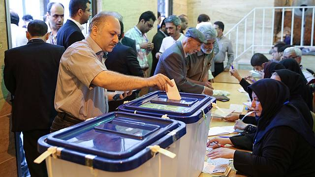 Iran voters face stark choice in presidential poll