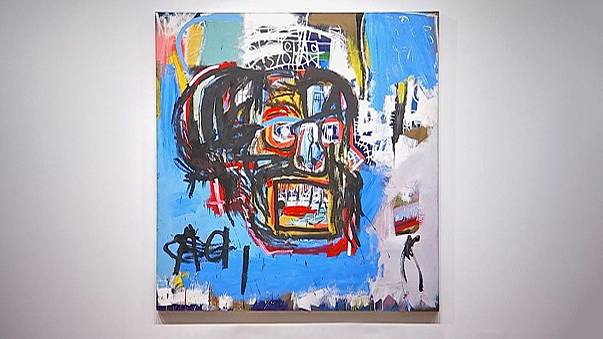 Sold! Basquiat 'skull' canvas goes for 84 million euros at 'electrifying' auction