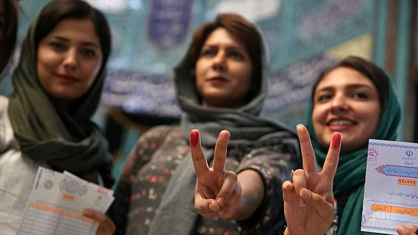 Voting extended amid high turnout in tight Iran election