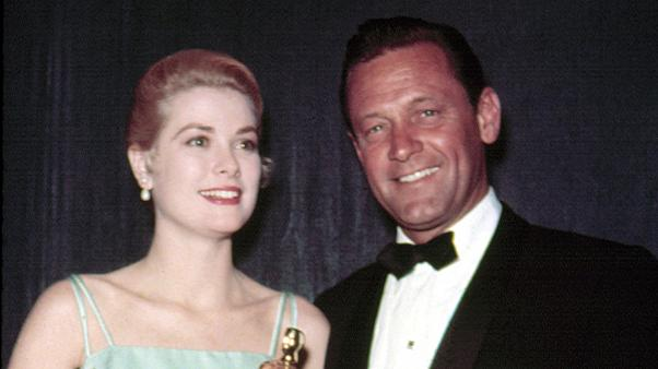 1954: Best Actress GRACE KELLY [The Country Girl] accepts Oscar from the pr