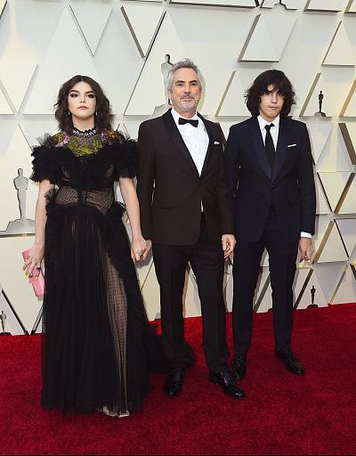 "Director Alfonso Cuaron brought his daughter, Tess Bu Cuaron, and son Olmo Teodoro Cuaron on a night when ""Roma"" brought home multiple Oscars."