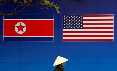 A banner showing North Korean and U.S. flags ahead of the this weeks summit in Hanoi.