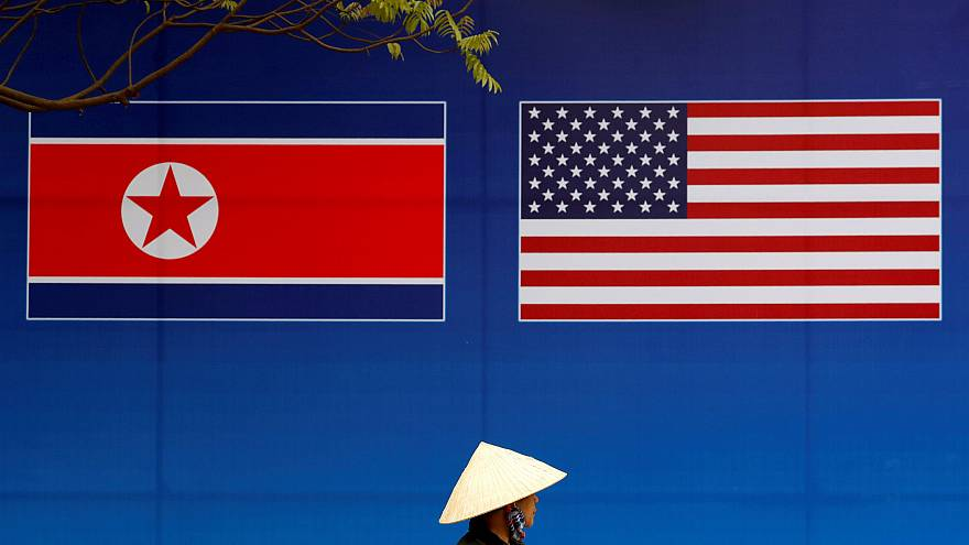 Image: A banner showing North Korean and U.S. flags ahead of the this weeks