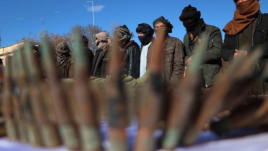 Image: Militants surrender as part of reconciliation initiative