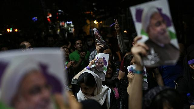 Iran: Rouhani supporters celebrate election victory into the night