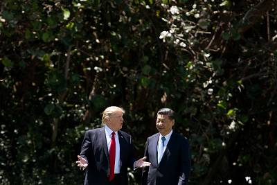 President Donald Trump, from left, and Chinese President Xi Jinping walk together at the Mar-a-Lago estate in West Palm Beach, Florida on April 7, 2017.