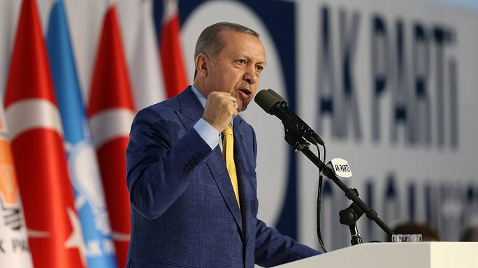 Erdogan back as head of AK Party