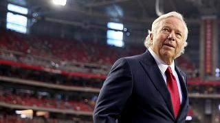 Image: Robert Kraft, owner of the New England Patriots, walks on the field