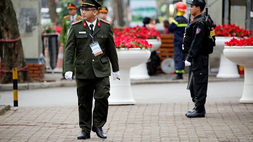 Image: Security officers stand guard at Melia Hotel before the Trump-Kim su