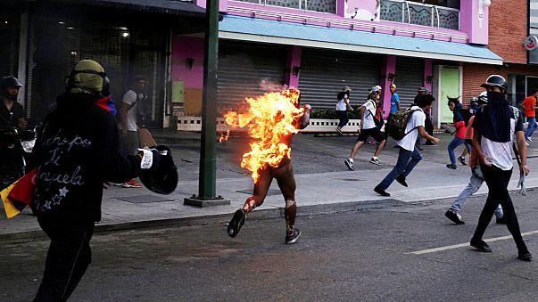 Man set on fire as violent turmoil sweeps Venezuela