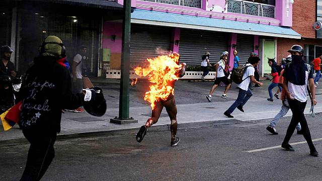 Man set on fire as violent turmoil sweeps Venezuela