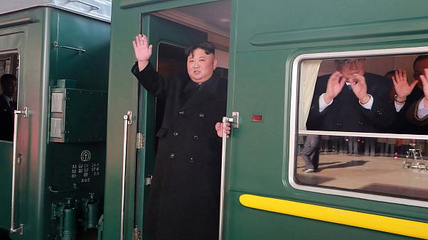 Image: Kim Jong Un waves from his train before leaving Pyongyang on his way