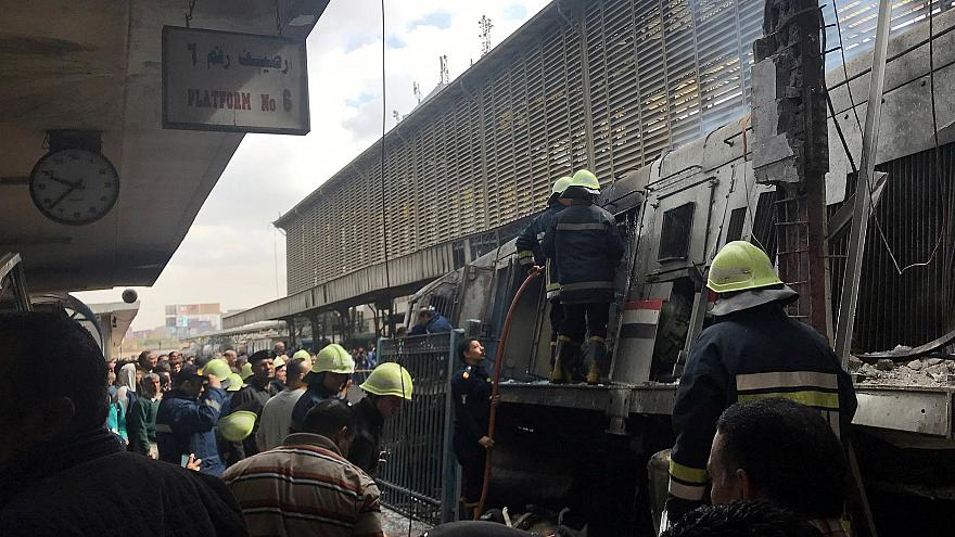 Image: Rescue workers attend a fire at the main train station in Cairo