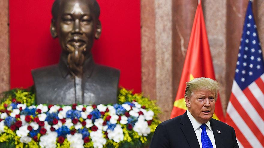 Image: President Donald Trump stands next to a bust of late president Ho Ch