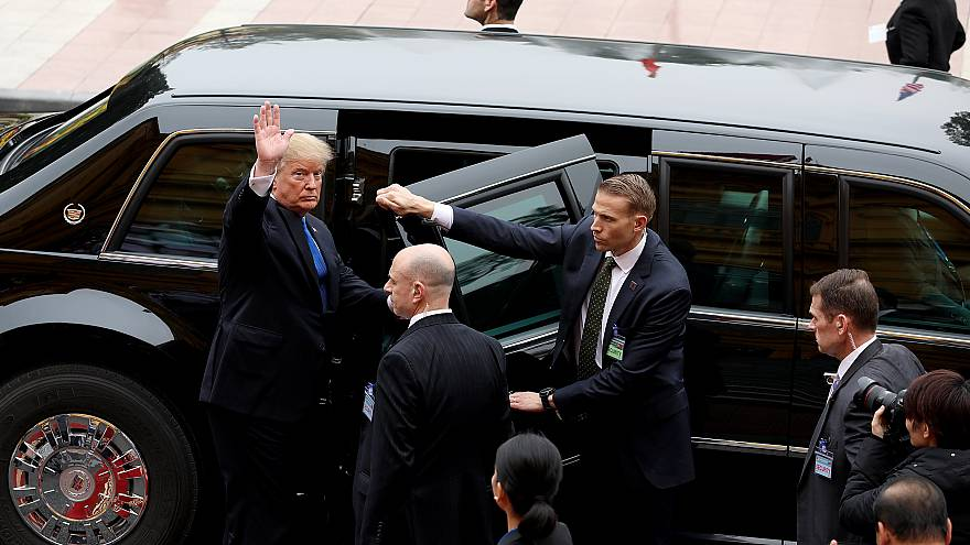 Image: President Donald Trump waves after a meeting in Hanoi, Vietnam, on F