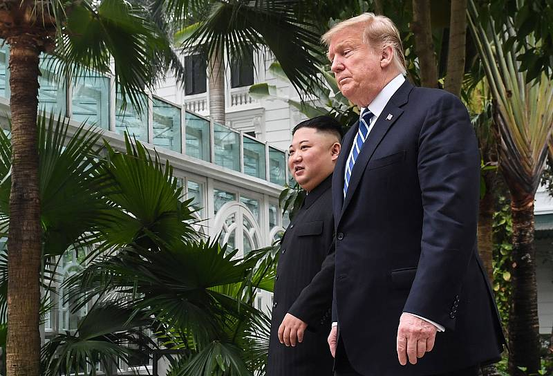 President Donald Trump walks with North Korea\'s leader Kim Jong Un during a break in talks in Hanoi, Vietnam, on Thursday.