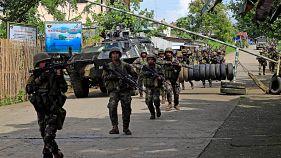 Philippine troops battle Islamists in besieged city
