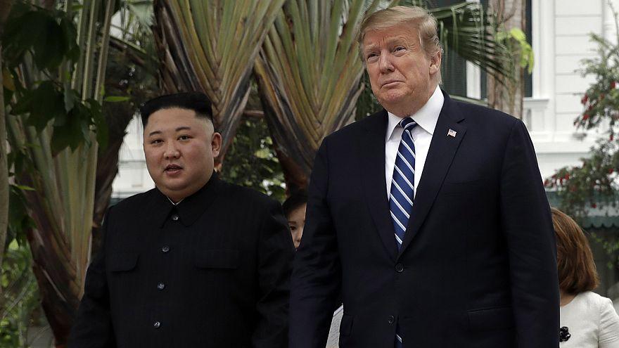 Image: President Donald Trump and North Korean leader Kim Jong Un take a wa