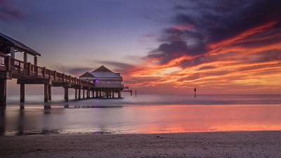 A deep red and purple sunset viewed from the side of Pier 60, Clearwater Beach, Florida, USA