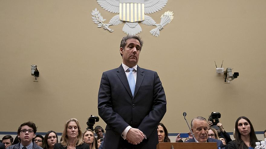 Image: Michael Cohen, President Donald Trump's former personal lawyer, paus