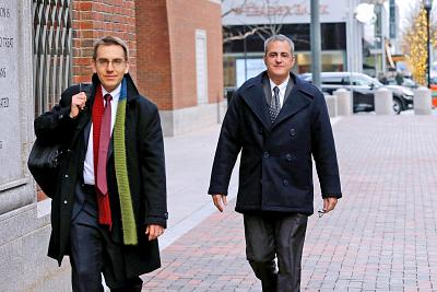 Alec Burlakoff, right, leaves federal court in Boston after reaching a plea deal with prosecutors in November 2018.