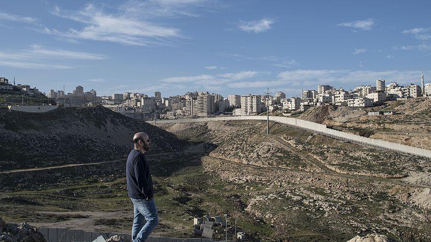 Image: Anti-settlement activist Shabtay Bendet surveys the highway critics