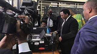 President Kabila registers to vote in DR Congo's uncertain election