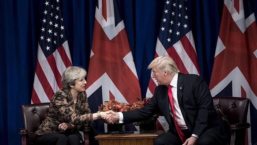 Image: British Prime Minister Theresa May shakes hands with President Donal