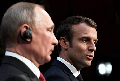Vladimir Putin shows little appreciation of Emmanuel Macron's speech
