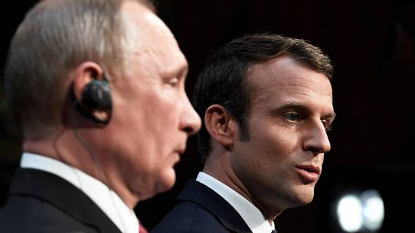 Vladimir Putin shows little appreciation of Emmanuel Macron's speech
