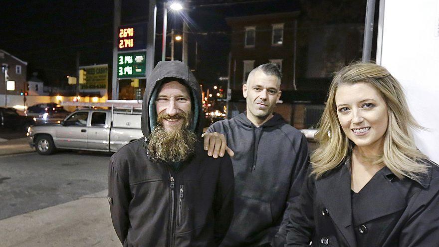Johnny Bobbitt Jr., left, Kate McClure, right, and McClure's boyfriend Mark