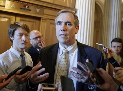 Sen. Jeff Merkley, D-Ore. speaks to reporters just outside the Senate chamber on Capitol Hill on April 5, 2017 in Washington.
