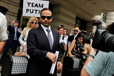 Former Trump campaign aide George Papadopoulos with his wife Simona Mangiante leaves after his sentencing hearing at U.S. District Court in Washington, on Sept. 7, 2018.