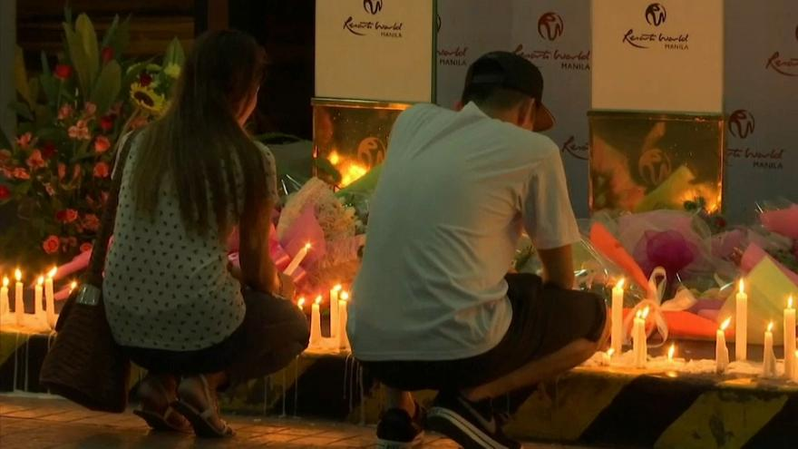 Flowers and candles brought to Resorts World complex in Manila
