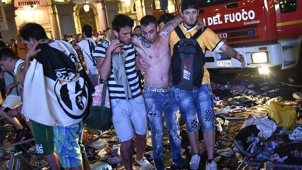 Hundreds of football fans hurt in Turin stampede