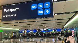 Image: Signage is seen at the UK border control point at the arrivals area
