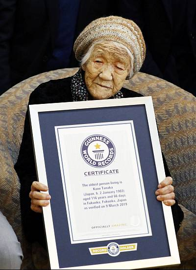 116-year-old Japanese woman Kane Tanaka holds a Guinness World Records certificate naming her as the world\'s oldest person living during a ceremony in Fukuoka, Japan, on March 9, 2019.