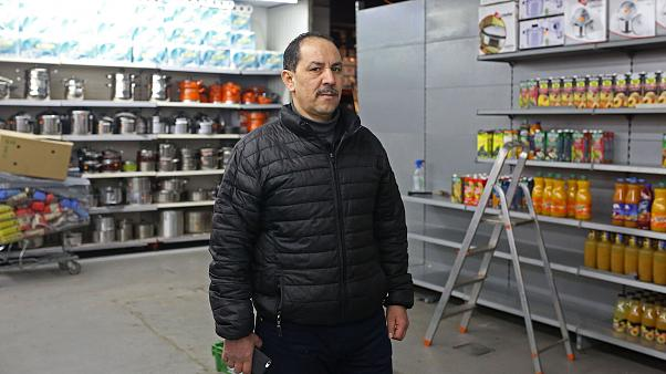 Image: Bouihrouchane Mbark pictured alongside the empty meat section of his
