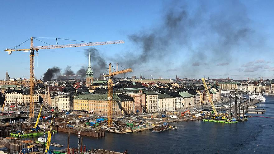 Image: Smoke rises over Stockholm after a bus exploded on March 10, 2019.