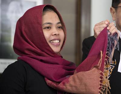 Siti Aisyah, left, smiles after a press conference at the Indonesian Embassy in Kuala Lumpur, Malaysia, on Monday.