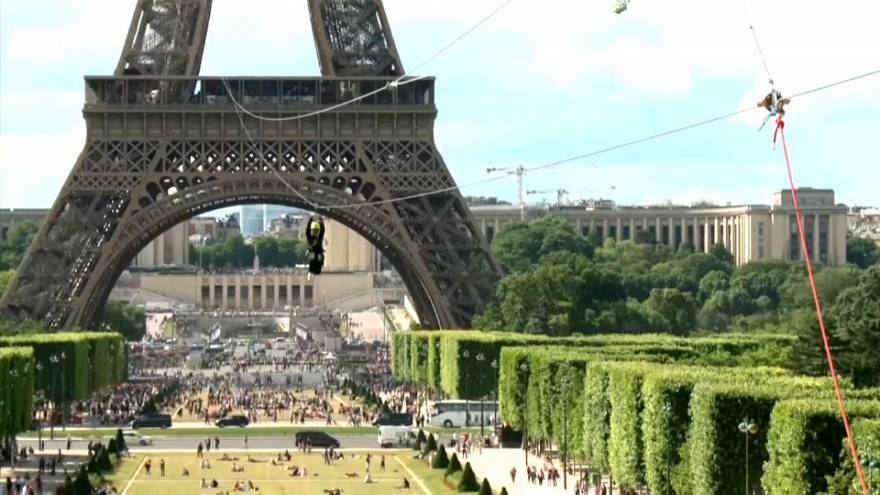 Daredevil zip-lining off the Eiffel Tower