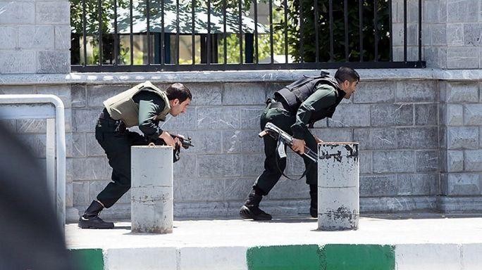 Twelve dead as assailants dressed as women attack Iran capital
