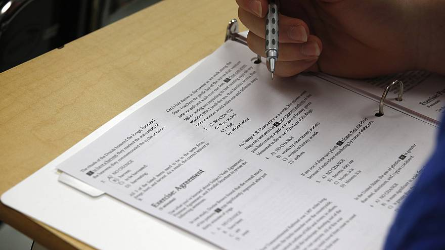 Image: A student takes a college preparation test at Holton Arms School in