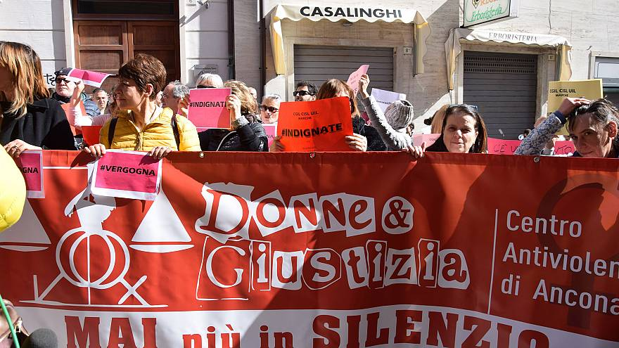 Image: A demonstration outside Ancona's court after it emerged that two men