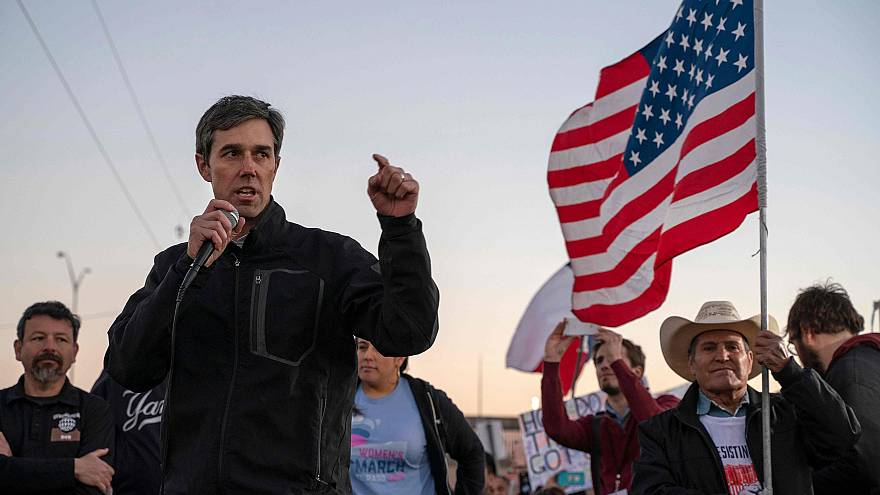 Image: Former Texas Congressman Beto O'Rourke speaks to a crowd of marchers